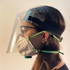 profile view of female wearing face shield and face mask