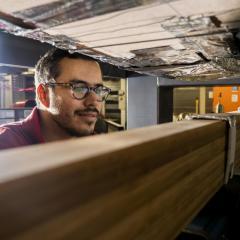 UQ PhD candidate Mateo Gutierrez tests engineered bamboo beams in the UQ Fire laboratory.