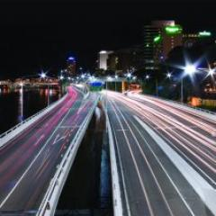 high-speed photograph of motorway at night