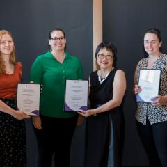 Photo of staff receiving awards from Vicki Chen, Executive Dean